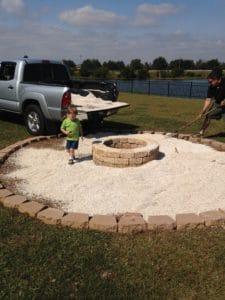 adding the pea gravel around the DIY Fire Pit