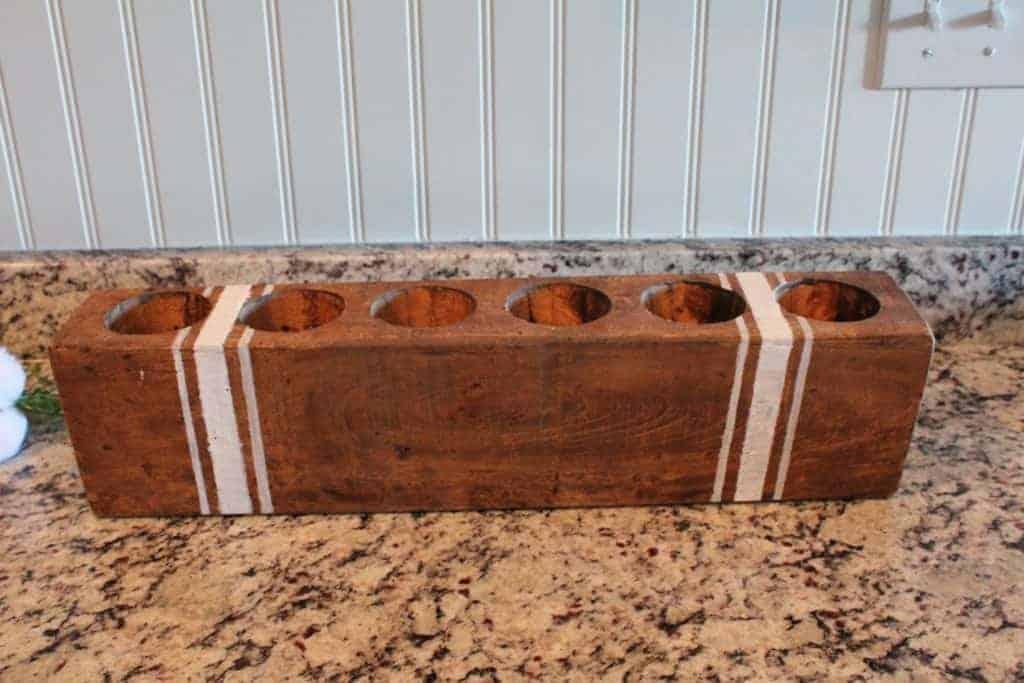 vintage sugar mold with grain sack stripes