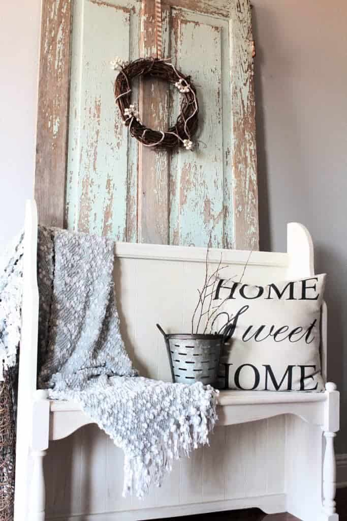 modern farmhouse entryway with chippy door