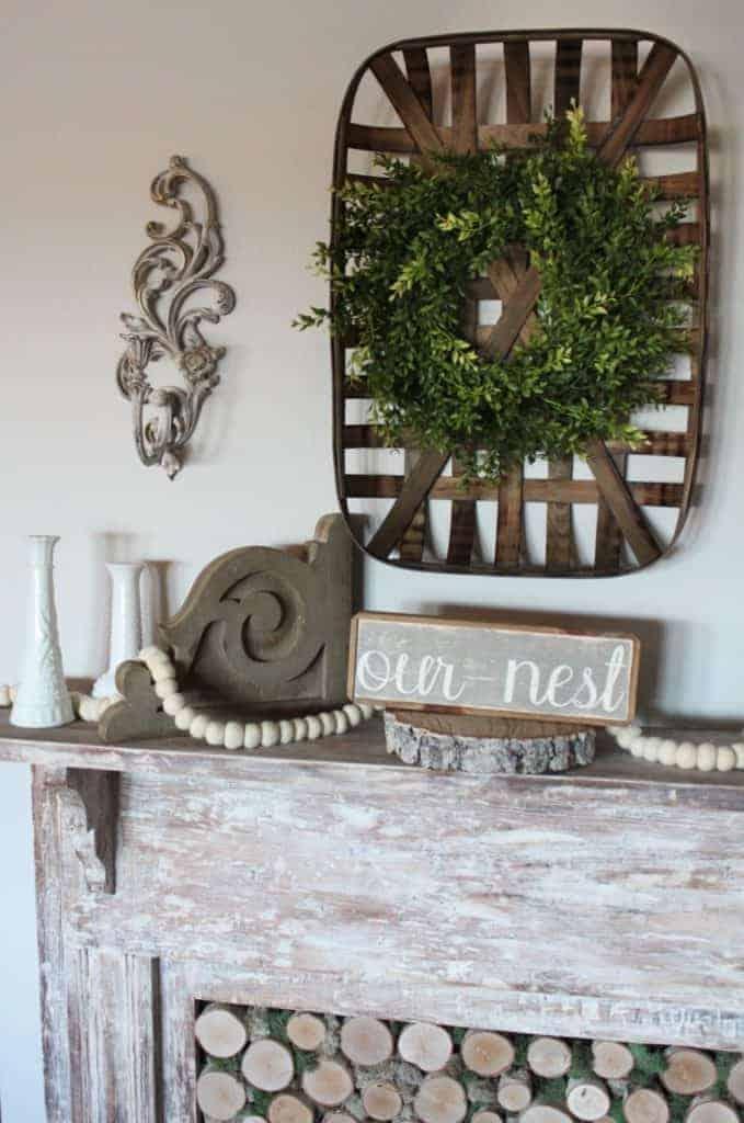 antique fireplace mantel with white wash finish