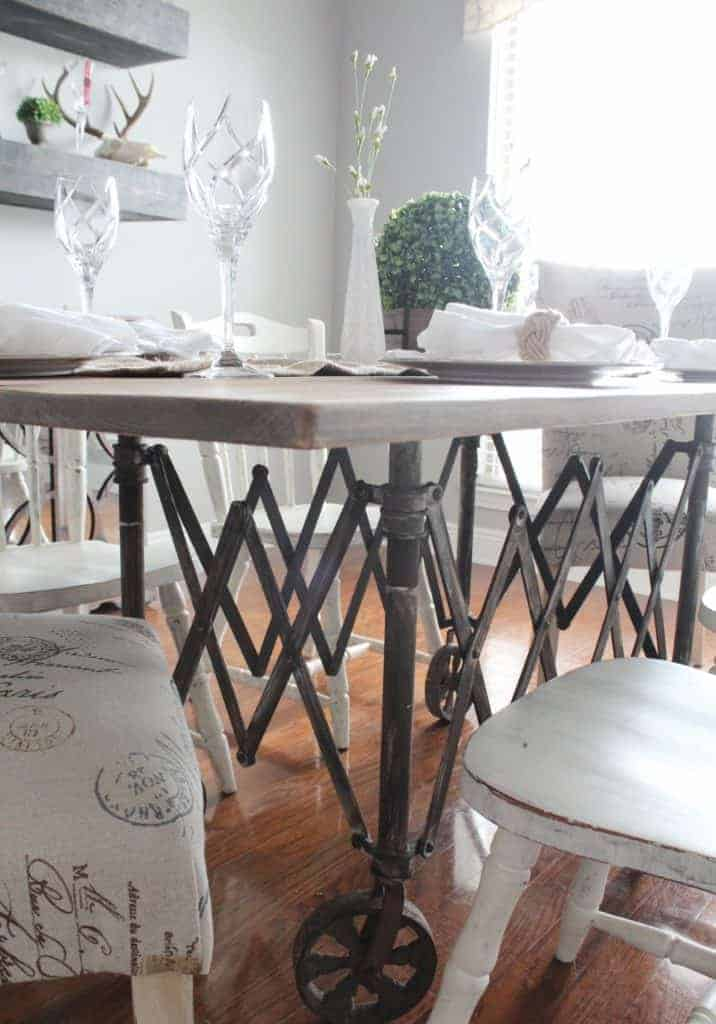 vintage casket carrier repurposed to a dining room table