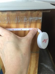 measuring the dresser drawers for the adhesive vinyl contact paper