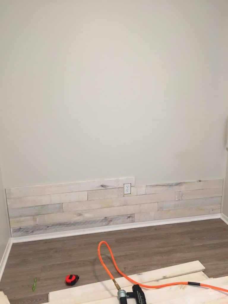 adding wall boards to the wall for the mudroom