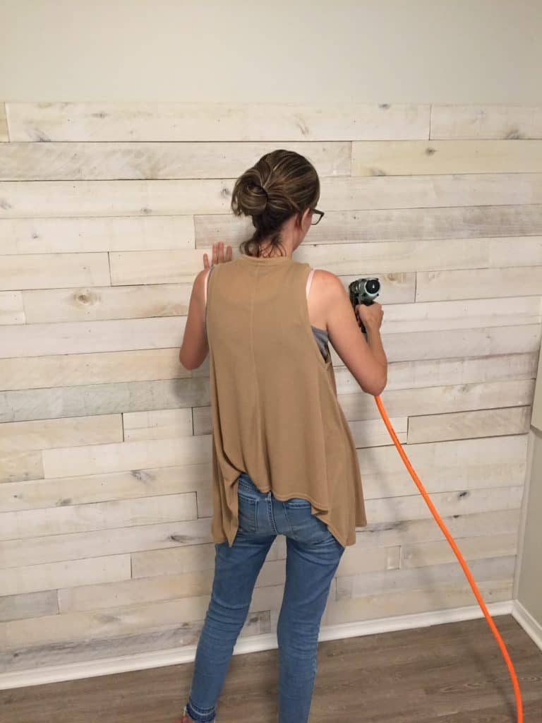 adding wall boards to the wall for mudroom