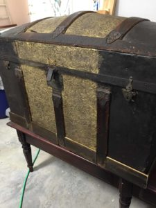 antique steamer trunk with new wood base