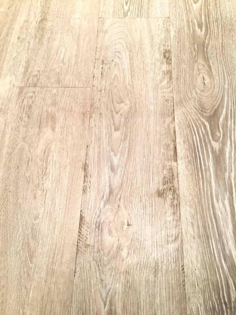 luxury vinyl tile with glue remnants