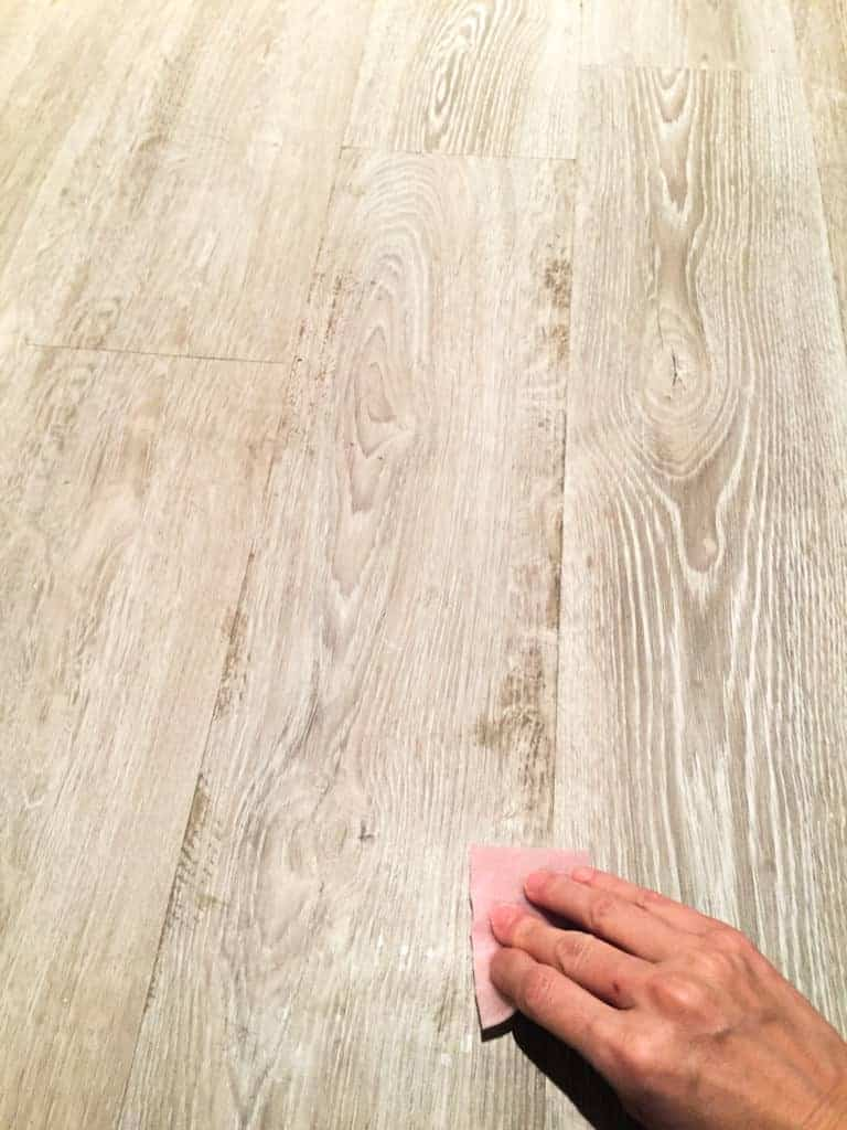 cleaning luxury vinyl tile with glue remnants