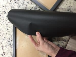 adding black contact paper to the filing cabinet