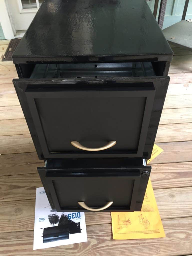 painting the filing cabinet with chalkboard paint