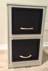adding the pulls to the filing cabinet
