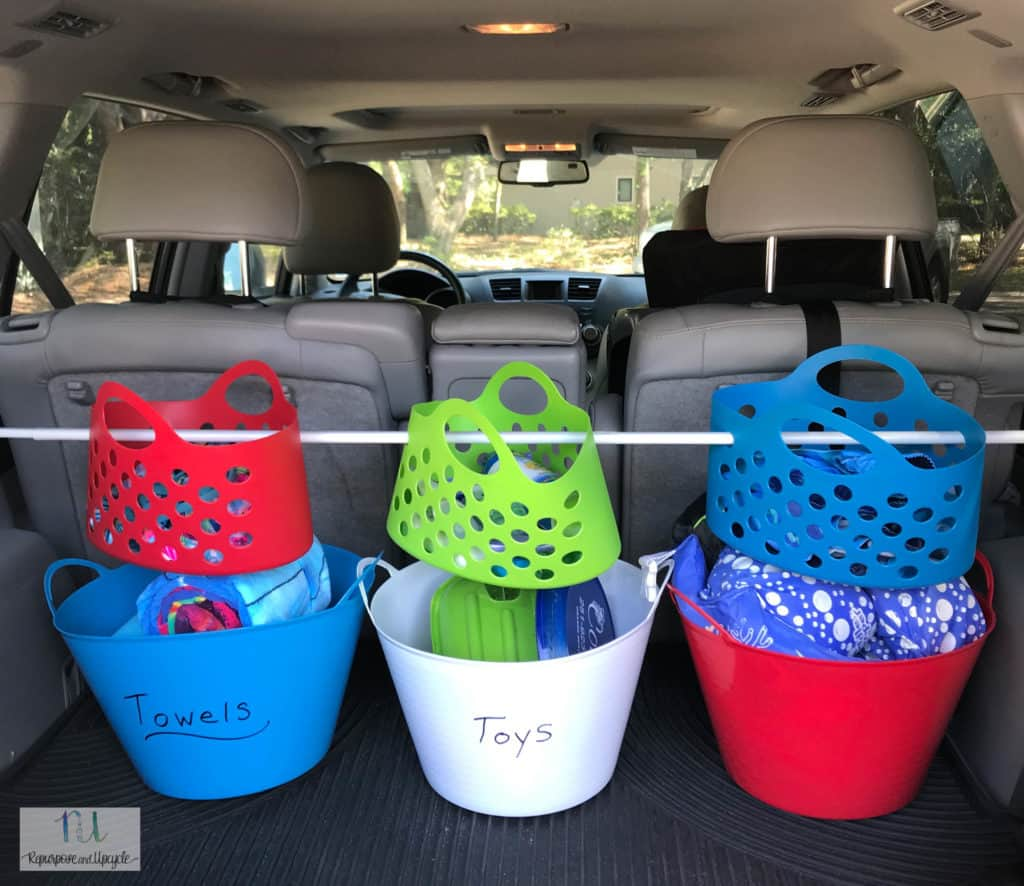 car organization with bins and tension rod from Dollar tree