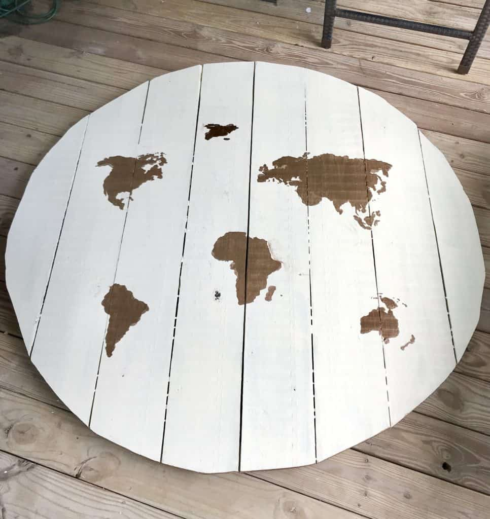 table top with painted world stencil