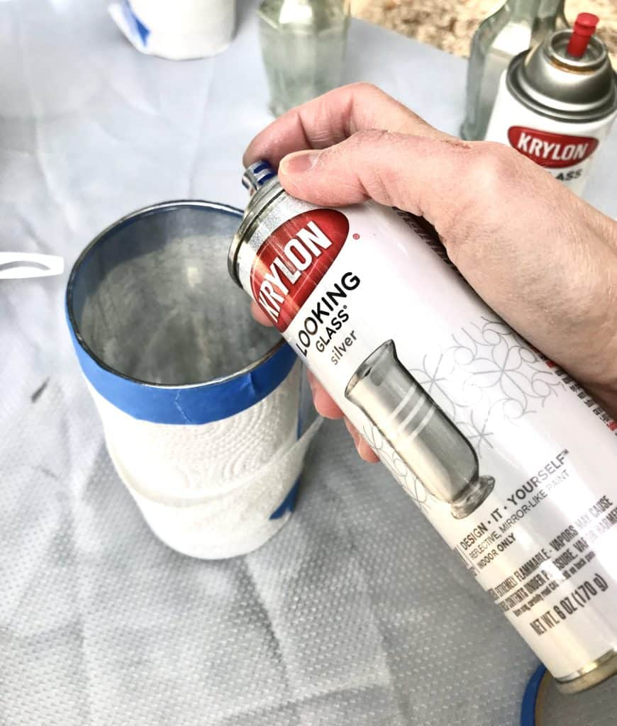 applying the DIY Mercury glass with Krylon looking glass spray paint