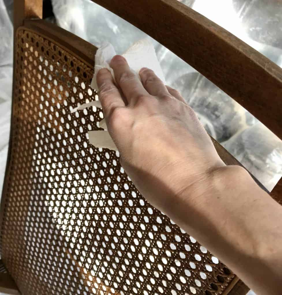 wiping off cane back chairs