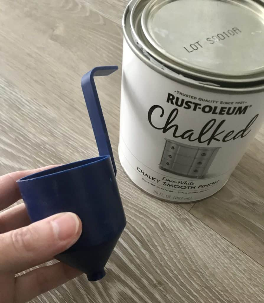 cup that tests the viscosity of the chalk paint for the paint sprayer