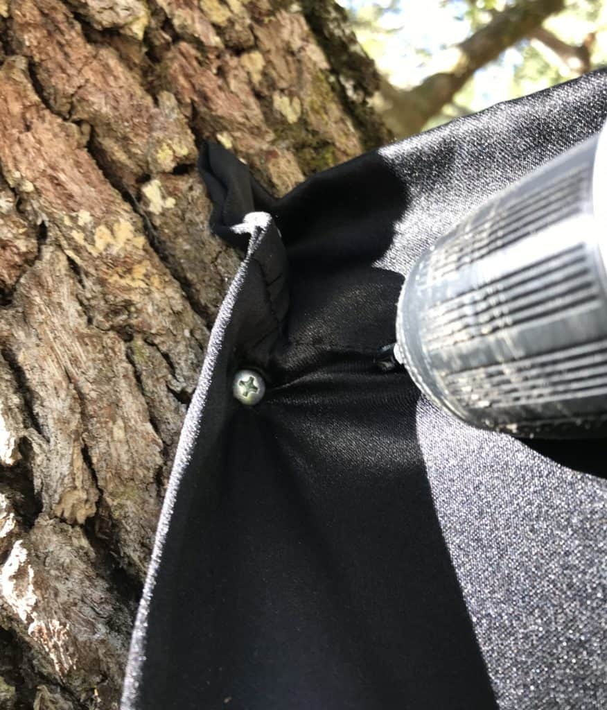 using screw to attach sheet to tree