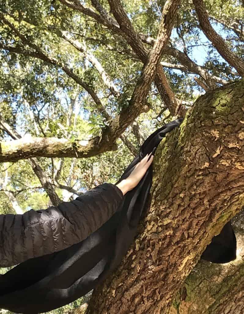 nailing sheet to tree