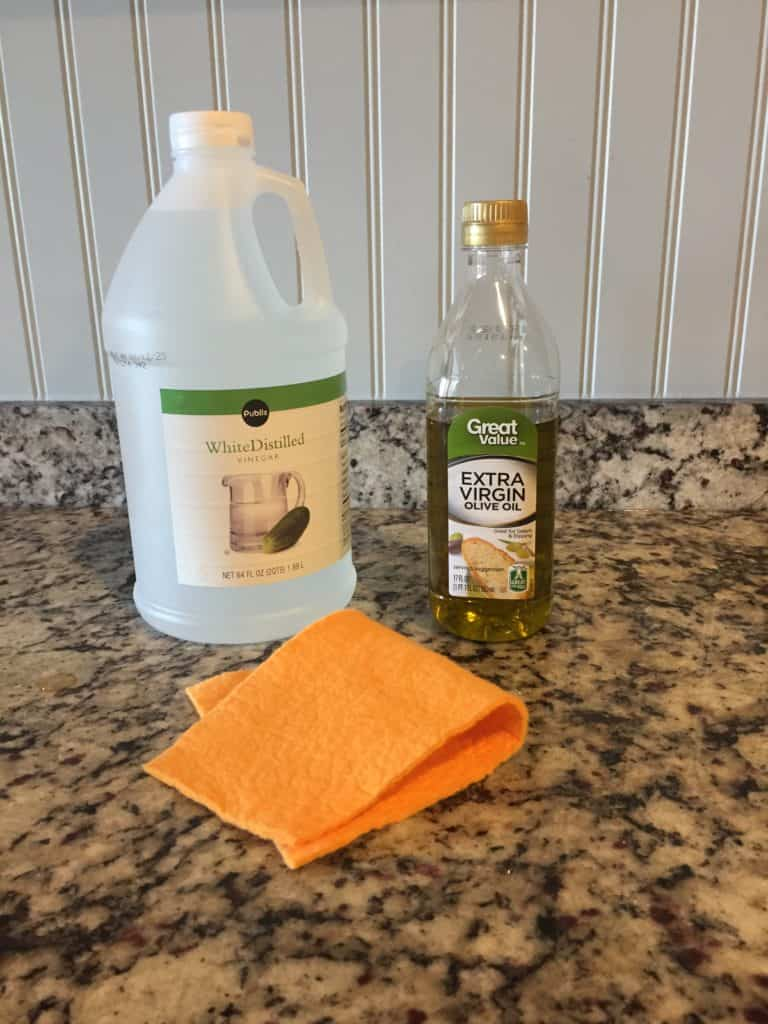 White distilled vinegar and olive oil used to remove wood scratches