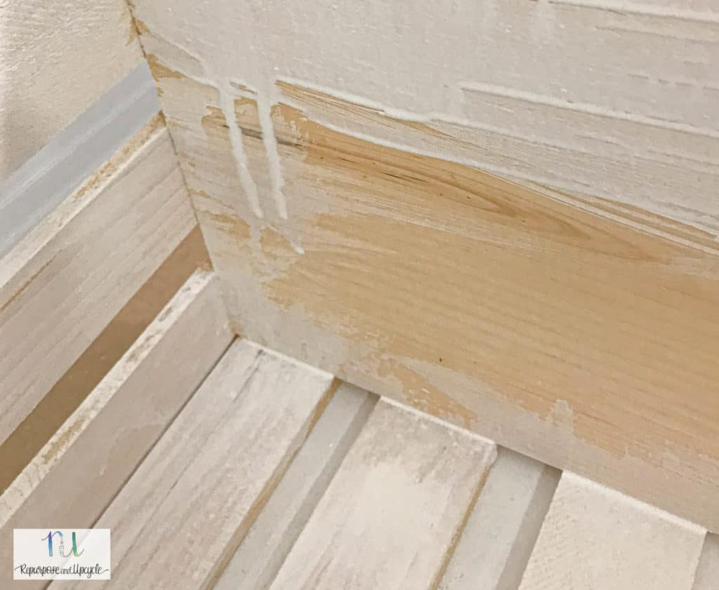 drips on the wood from the white wash