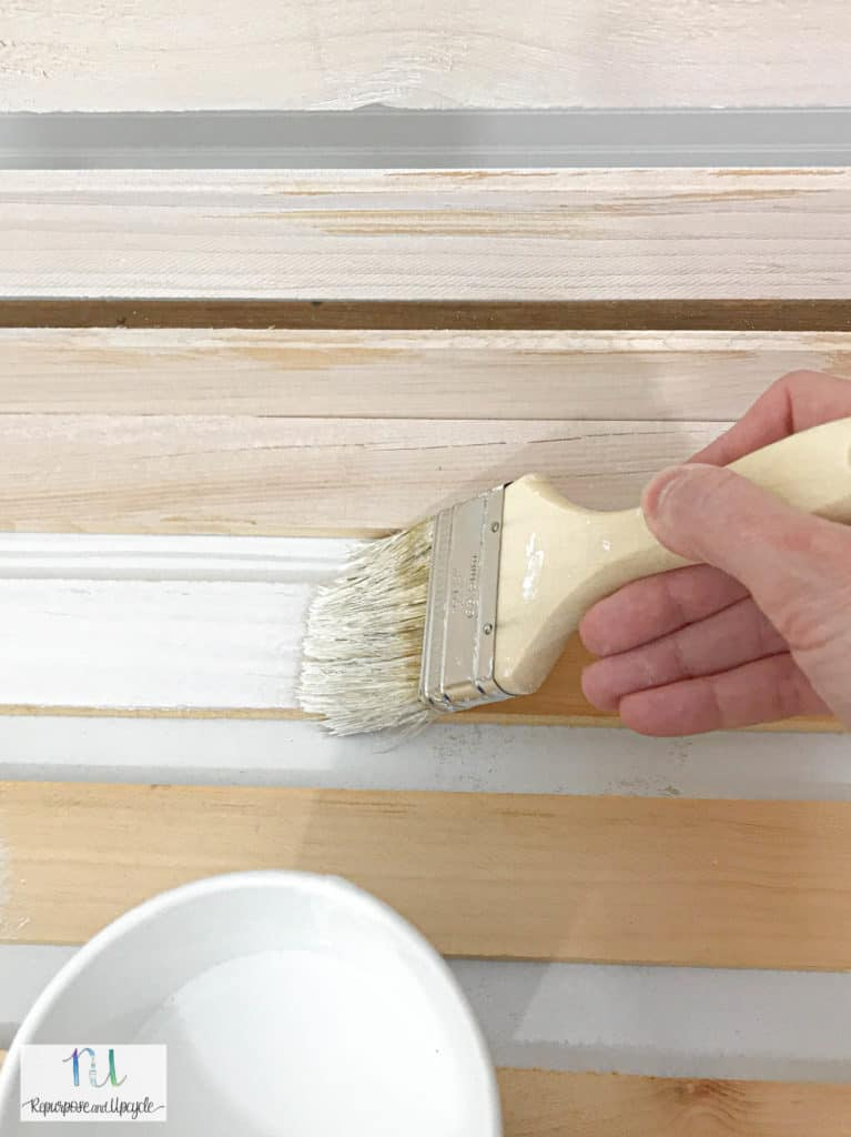 applying second coat of whitewash