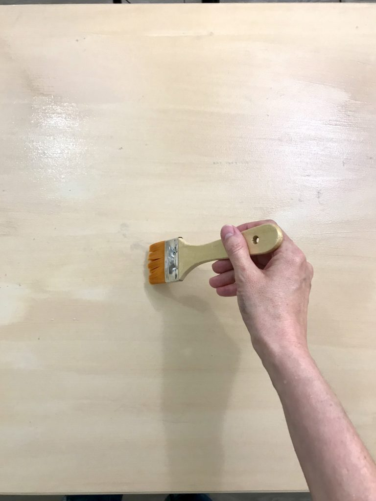 painting the first coat of Liquid Wood