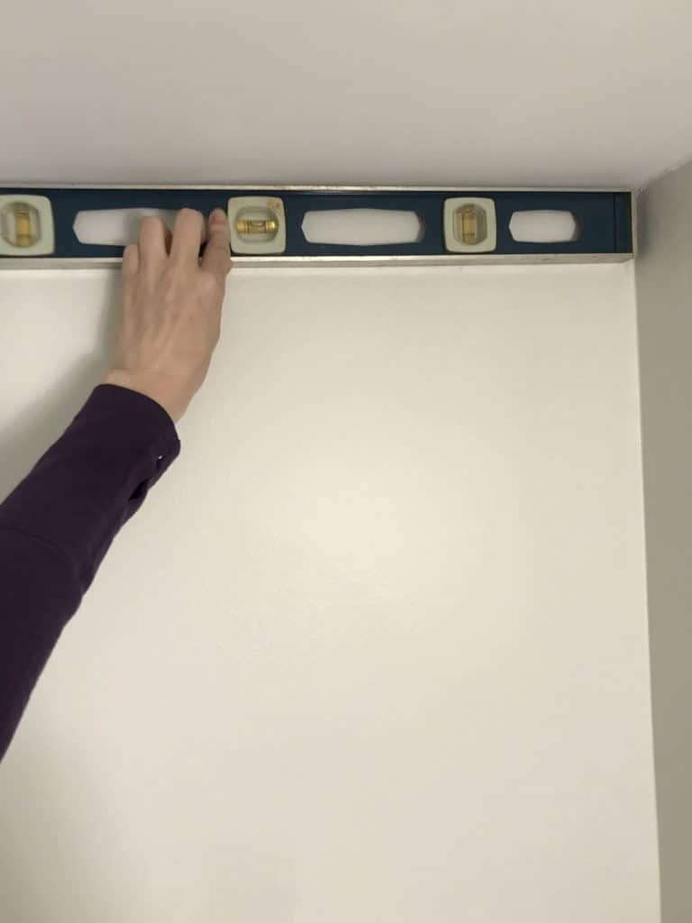 measuring the wall for the stencil