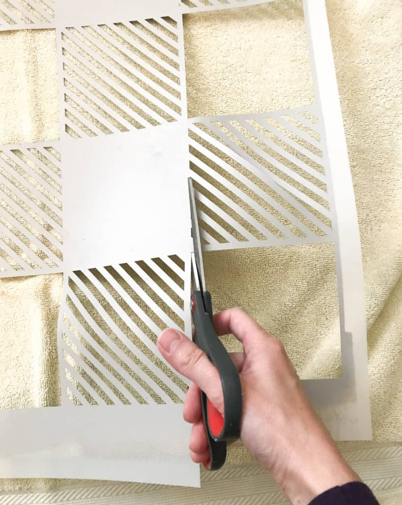 cutting the stencil to fit the wall