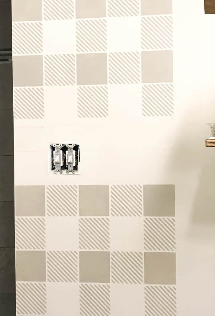stenciling a wall around a light switch