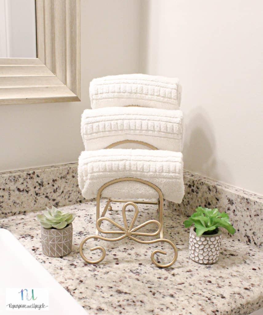 repurposed plate rack to towel holder