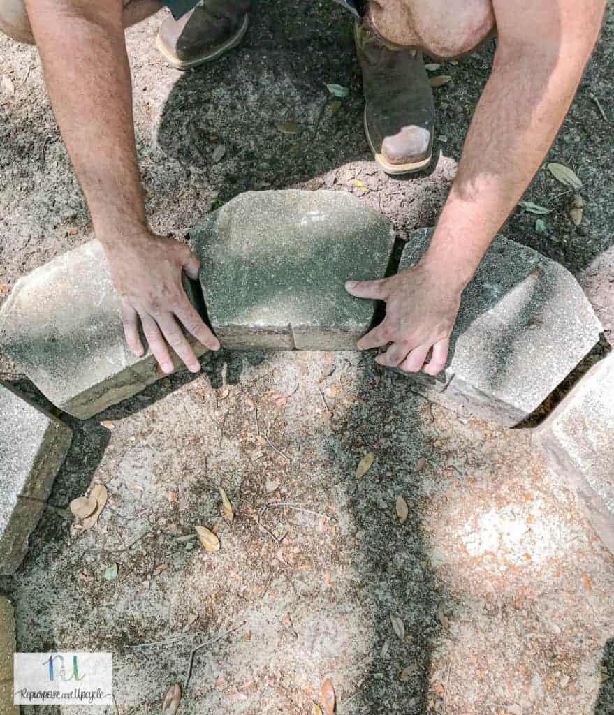 placing concrete pavers for fire pit