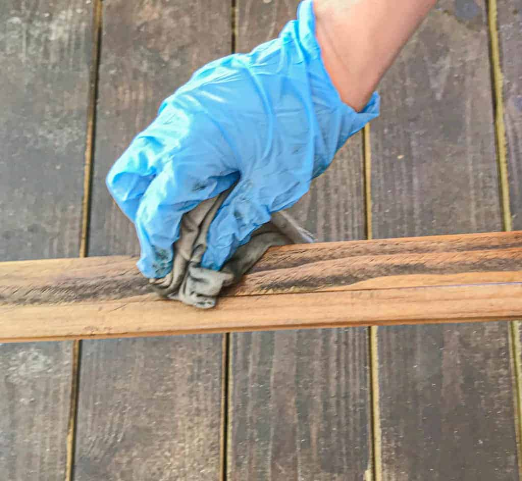 wiping the stain away from the wood