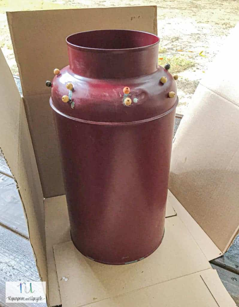 spray painting the vintage milk can