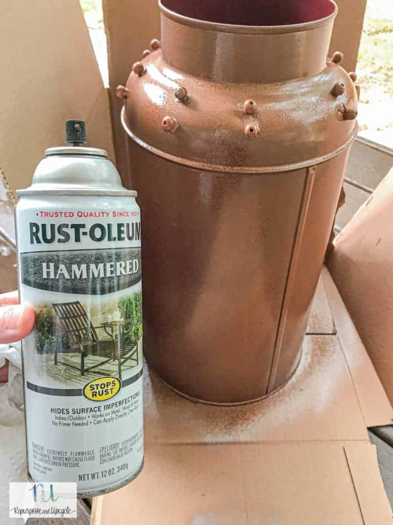 first coat of copper spray paint on the milk can