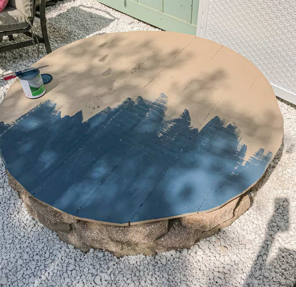 painting the outdoor table around the gravel patio