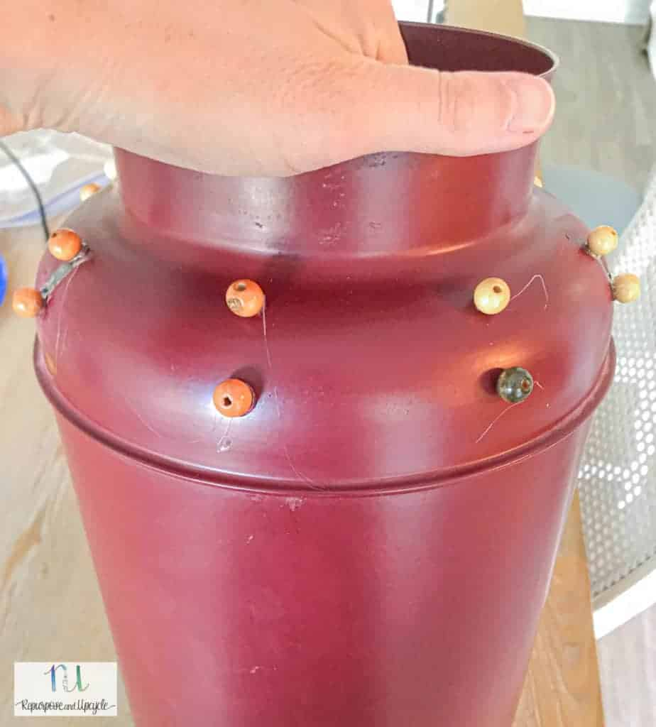the milk jug with the beads glued on