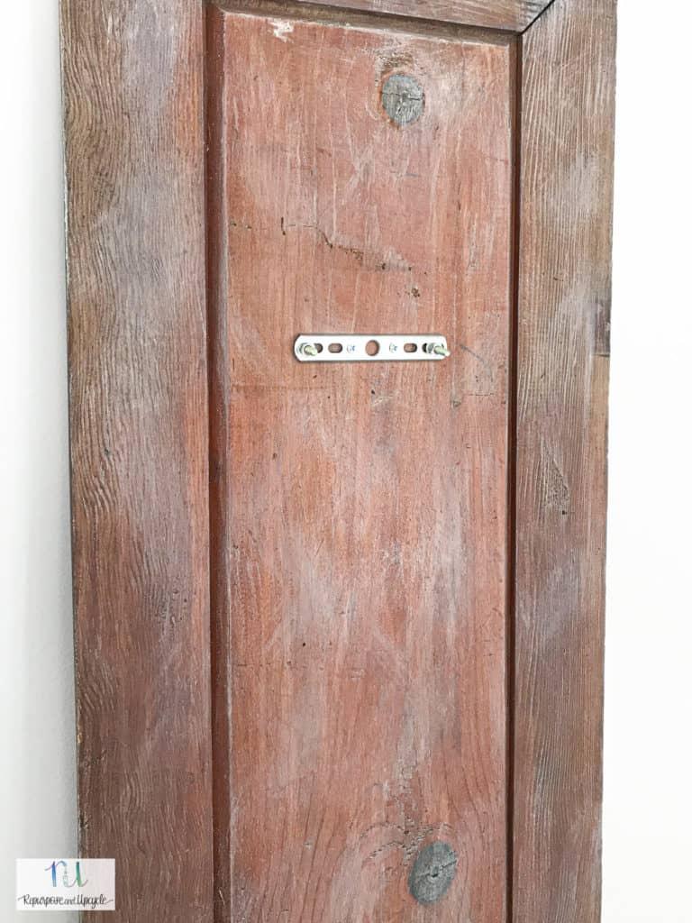 installing sconce hardware on vintage door