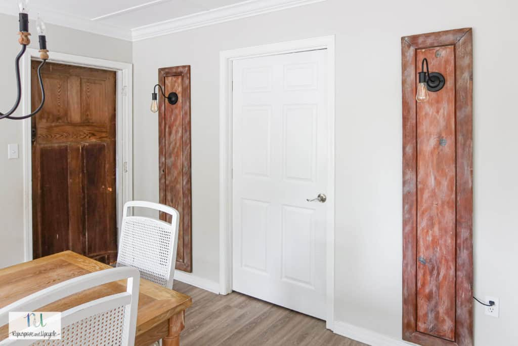 repurposed doors with light sconces