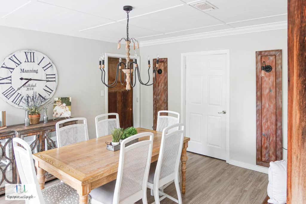 dining room with Repurposed vintage doors with sconce lights