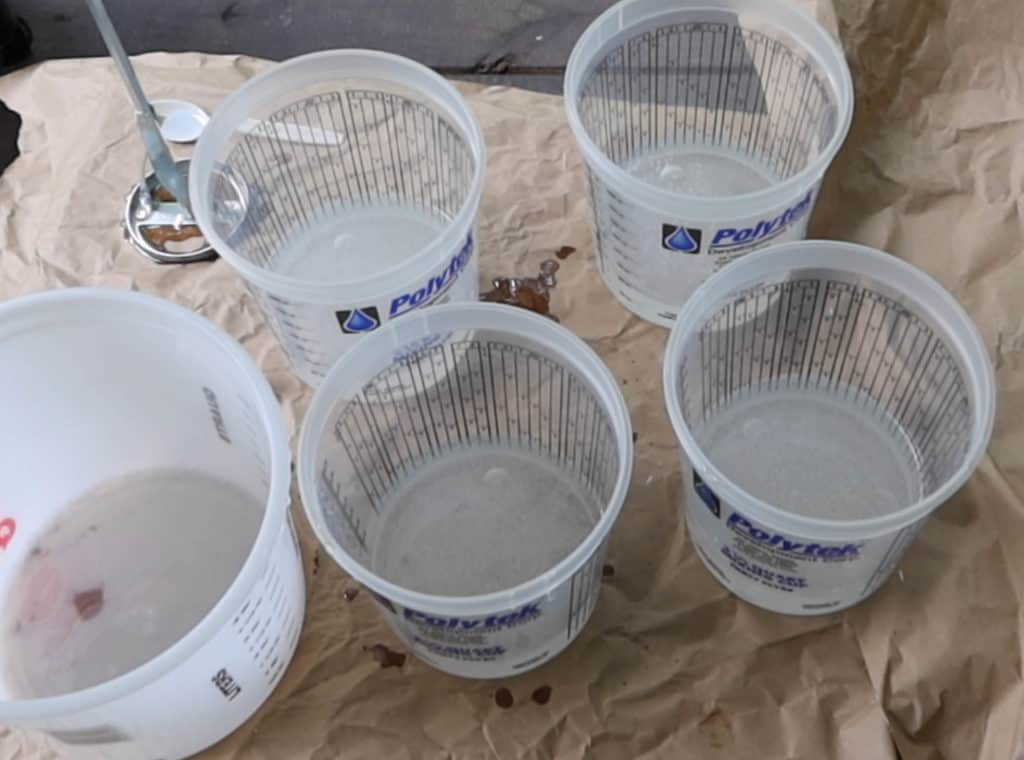 Epoxy poured into different buckets
