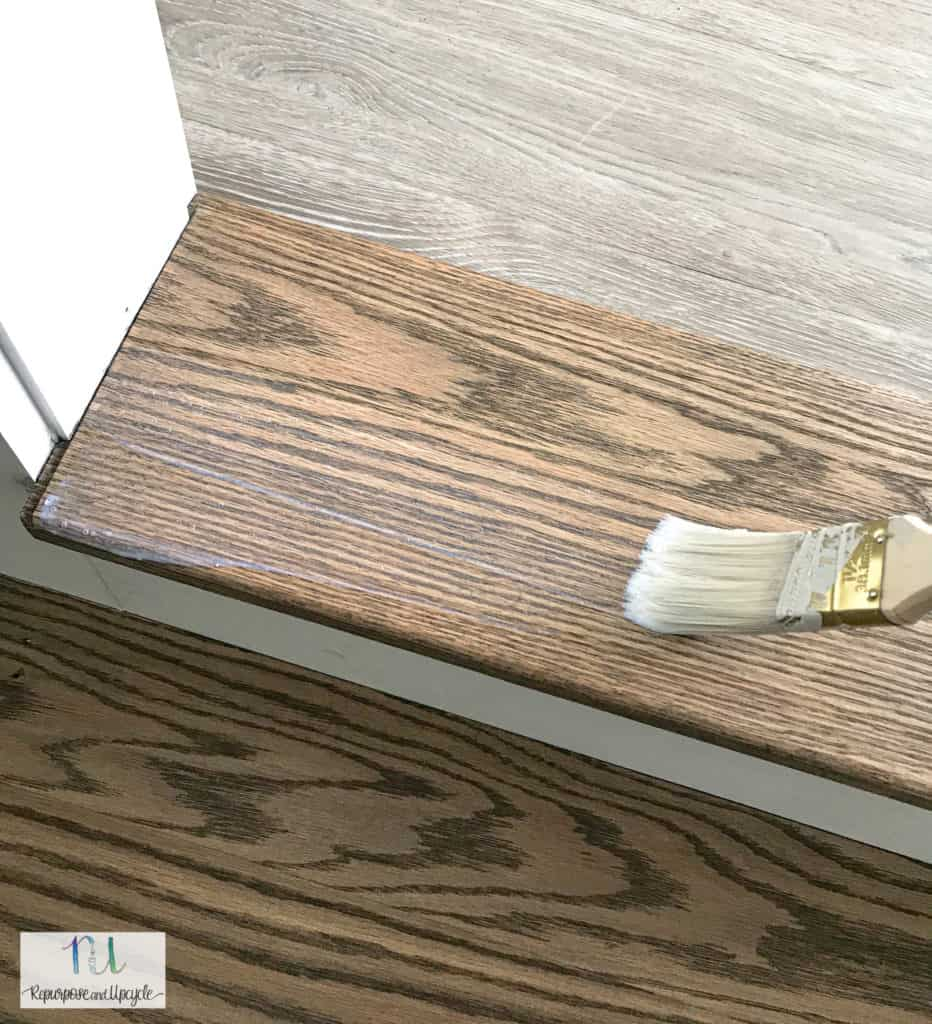 applying a sealer over Oak wood stairs