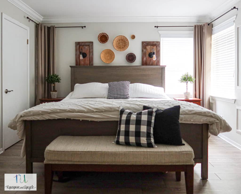 master bed in front of corner windows