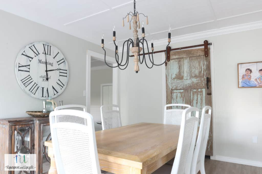 cottage style dining room with chippy barn door