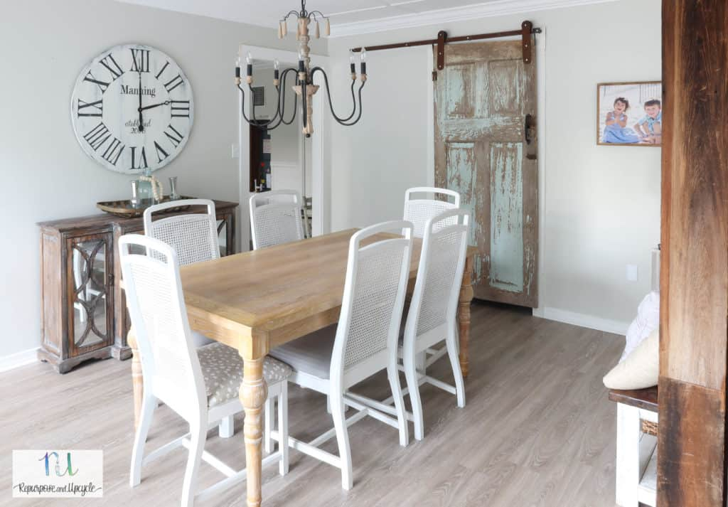 dining room with chippy barn door