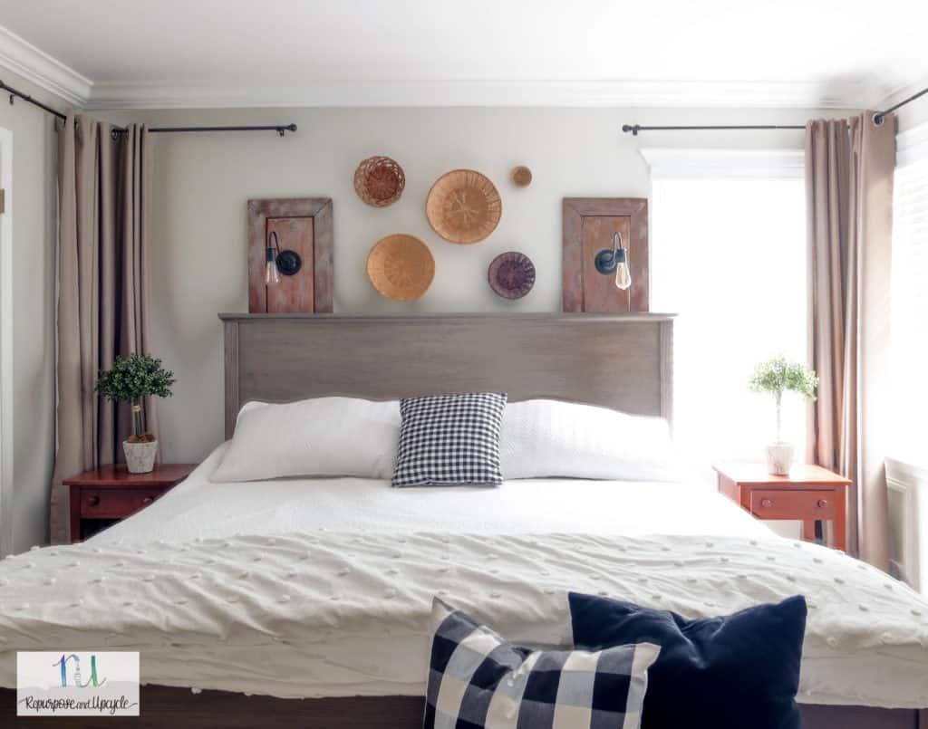bed in front of corner windows