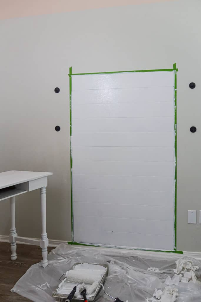applying primer to accent wall