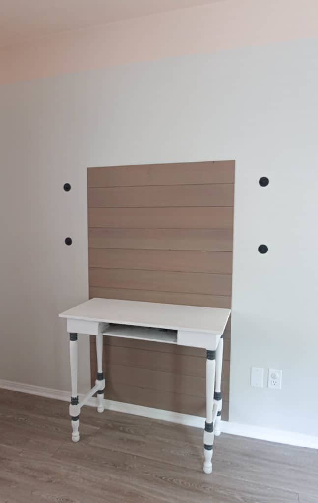 desk with wood planks behind it