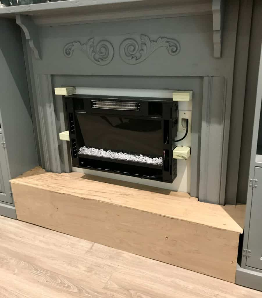DIY fireplace hearth around an electric fireplace