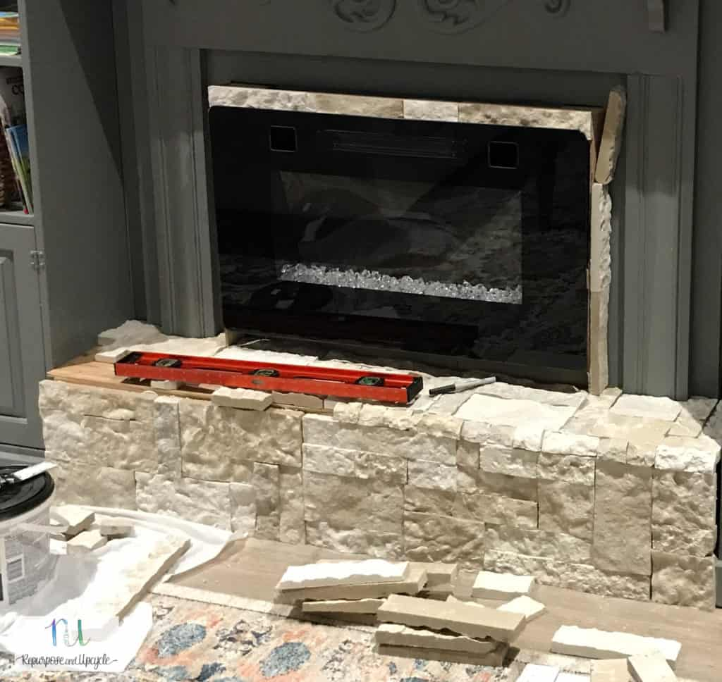 applying AirStone around an electric fireplace