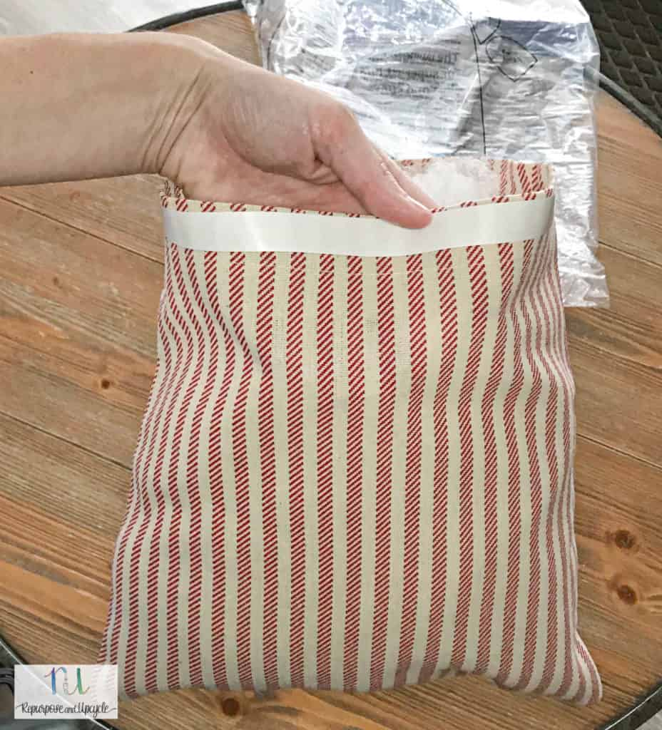Adding no sew tape to the edge of the pillow cover