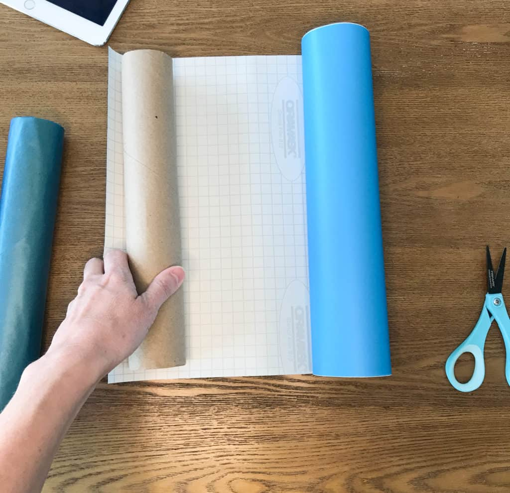 covering paper towel tube in contact paper